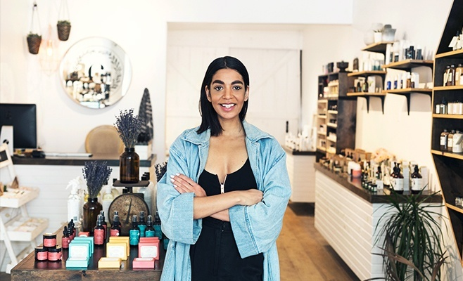 Small Australian retail business owner stands in her retail flagship store.